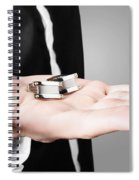 A Male Model Showcasing Cuff Links In His Hand Spiral Notebook
