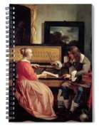 A Man And A Woman Seated By A Virginal Spiral Notebook