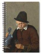A Man Holding A Tankard And A Glass Spiral Notebook