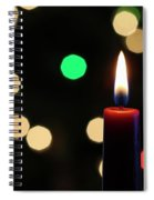 A Red Christmas Candle With Blurred Lights Spiral Notebook