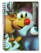 A Rudolph The Red Nosed Reindeer Ornament With A Penguin Spiral Notebook