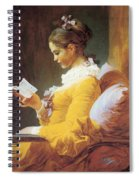 A Young Girl Reading Spiral Notebook