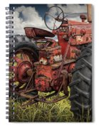 Abandoned Old Farmall Tractor In A Grassy Field Spiral Notebook