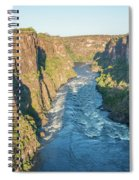 Aerial View Of Sunlit Rapids In Canyon Spiral Notebook