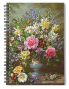 Bluebells Daffodils Primroses And Peonies In A Blue Vase Spiral Notebook