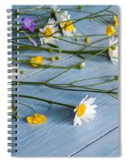 Bouquet Of Wild Flowers On A Wooden Spiral Notebook