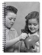 Boy And Girl Putting Money Into Piggy Spiral Notebook