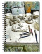 Ceramic Objects And Brushes On The Table Spiral Notebook