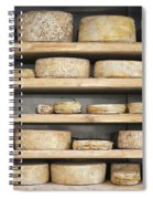 Cheese Wheels On Wooden Shelves In The Cheese Store Spiral Notebook