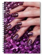 Closeup Of Woman Hands With Purple Nail Polish Spiral Notebook