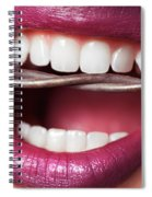 Closeup Of Woman's Mouth Biting On Barbed Wire Spiral Notebook