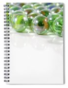 Composition With Green Marbles On White Background Spiral Notebook