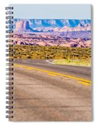 descending into Monument Valley at Utah  Arizona border  Spiral Notebook