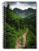 Dramatic Mountain Landscape With Distinctive Green Spiral Notebook