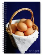 Eggs In A Wicker Basket. Spiral Notebook