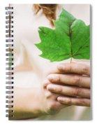 Female Hands Holding Leaf Spiral Notebook