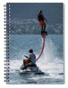 Flyboarder In Pink Shorts Above Jet Ski Spiral Notebook