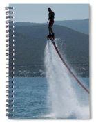 Flyboarder In Silhouette Balancing High Above Water Spiral Notebook