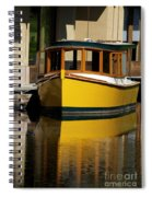 Gold Boat Reflects Spiral Notebook