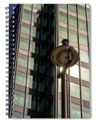 Lamp Post Against Green Glass Building Spiral Notebook