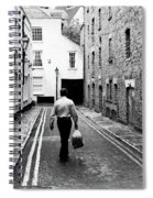 Man Walking With Shopping Bag Down Narrow English Street Spiral Notebook