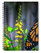 Monarch Butterfly Poised On Green Stem Among Yellow Flowers Spiral Notebook