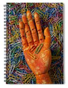 Orange Wooden Hand Holding Paperclips Spiral Notebook