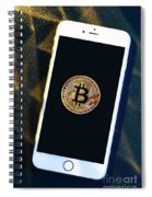 Phone With A Bitcoin Laying On Top Of It. Spiral Notebook