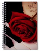 Rose With Sheet Music On Piano Keys Spiral Notebook