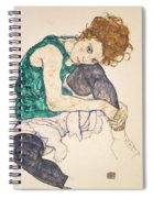 Seated Woman With Legs Drawn Up Spiral Notebook