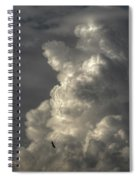 Silhouette Of An Eagle Flying Among Stormy Clouds  Spiral Notebook