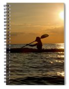 Silhouette Of Woman Kayaking In The Ocean. Spiral Notebook