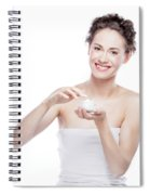 Smiling, Attractive Woman Using A Moisturizer. Spiral Notebook