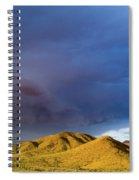 Storm Rolling Across Sun Dappled Mountains Spiral Notebook
