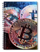 Three Bitcoin Coins In A Colorful Lighting. Spiral Notebook