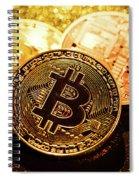 Three Golden Bitcoin Coins On Black Background. Spiral Notebook