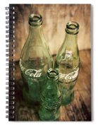 Three Vintage Coca Cola Bottles  Spiral Notebook
