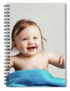 Toddler With A Cozy Blanket Sitting And Smiling. Spiral Notebook