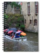 Tourists With Umbrellas In A Sightseeing Boat On The Canal In Bruges Spiral Notebook