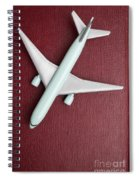 Toy Airplane Over Red Book Cover Spiral Notebook