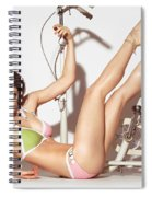 Young Woman In A Swimsuit Posing With Exercise Bike Spiral Notebook
