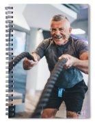 Senior Man Exercising With Ropes At The Gym. Spiral Notebook