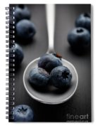 blueberries and a silver spoon on distressed wood No. 2 Spiral Notebook
