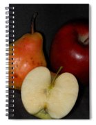 Half An Apple On Black Spiral Notebook