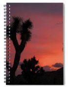 Joshua Trees Silhouetted Against A Red Sky Spiral Notebook
