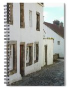 medieval cobbled street in Culross, fife Spiral Notebook