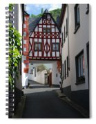 old historic street and woodframed house in Ediger Germany Spiral Notebook