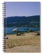 photograph of thid beach which is located in Stanley Park Vancouver. Third beach is a popular location for tourists and locals alike. Spiral Notebook