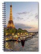 Portrait View Of The Eiffel Tower At Night With Wine Glass In The Foreground Spiral Notebook