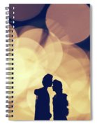 Romantic Couple Kissing On Illuminated Background. Spiral Notebook